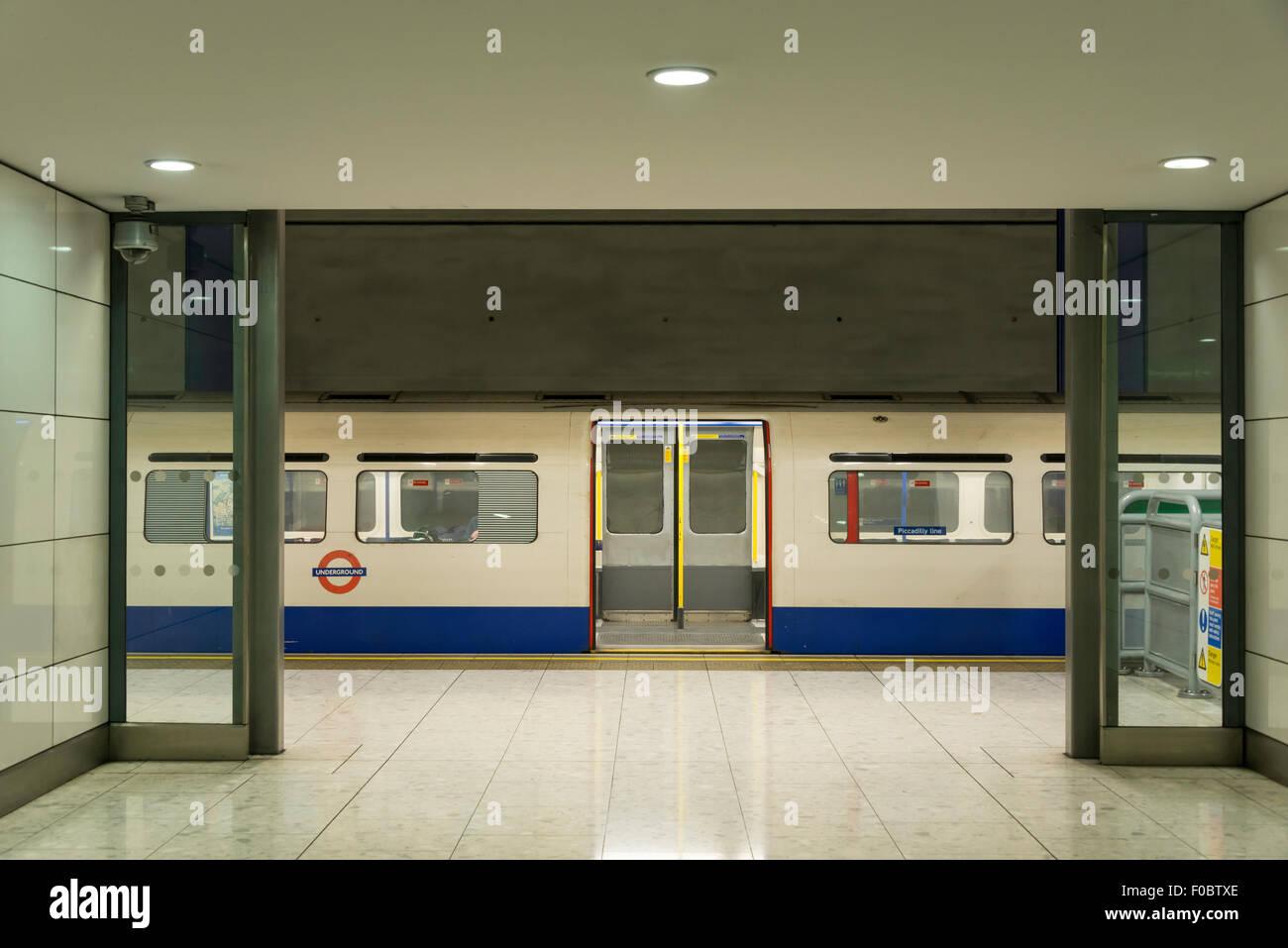 Train at platform, Terminal 5 Underground, Heathrow Airport. London Borough of Hounslow, Greater London, England, - Stock Image