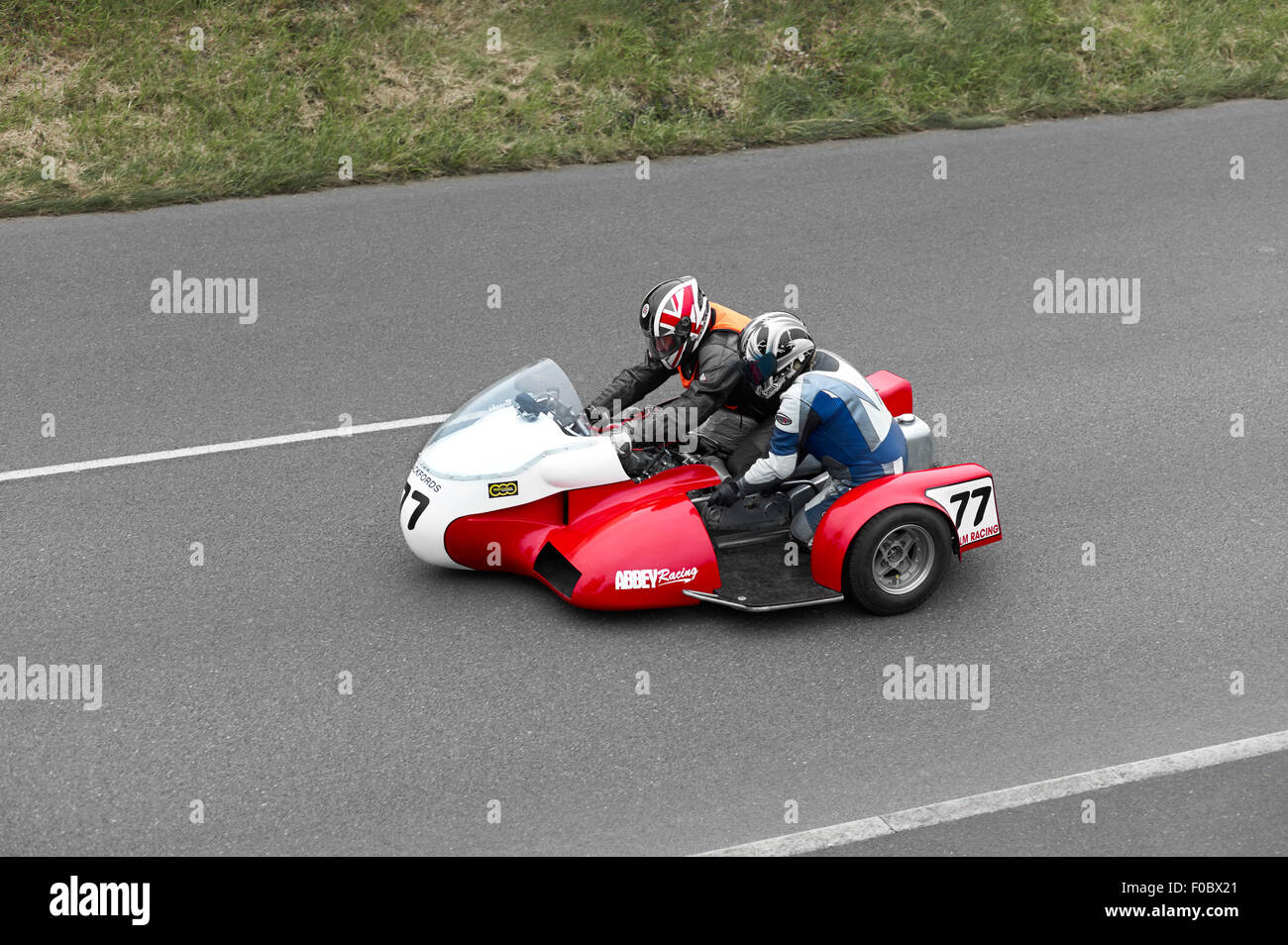 Steve Brooks on no77 sidecar at the 2015 Southern 100 races - Stock Image