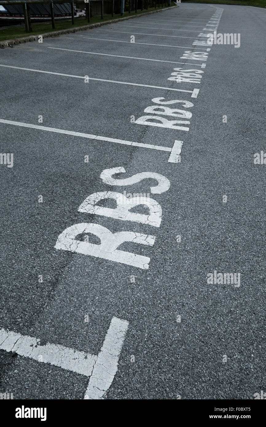 RBS line of empty car parking spaces Stock Photo