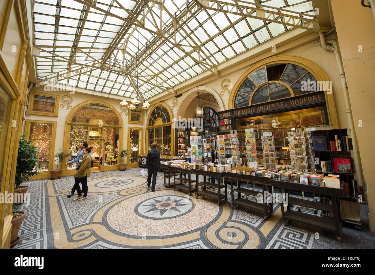 Galerie Vivienne is an ancient historical shopping passage with shops, cafe's, and restaurants. I Stock Photo