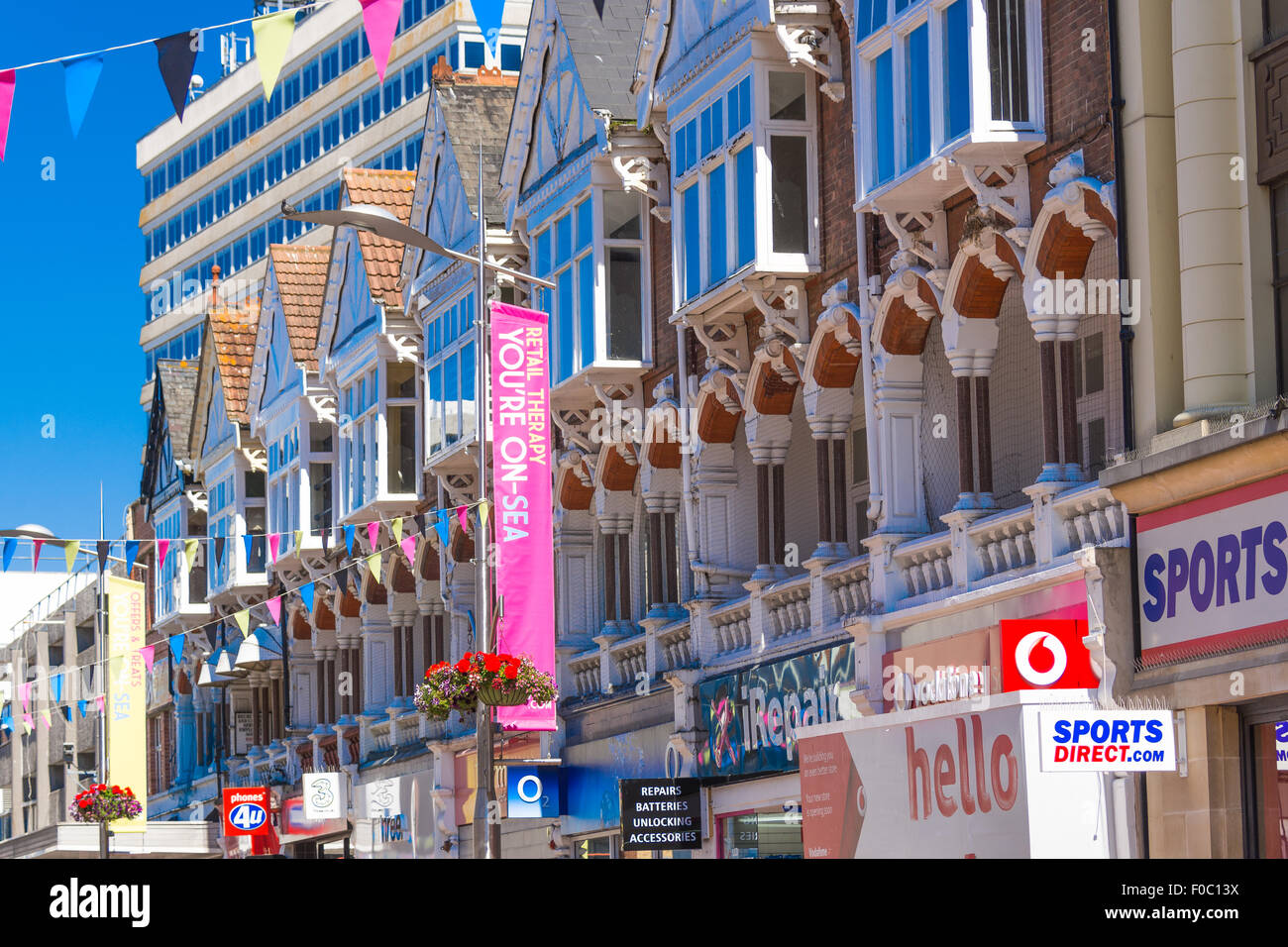 Row of Victorian shop fronts on Southend-on-Sea High Street with banners and bunting - Stock Image