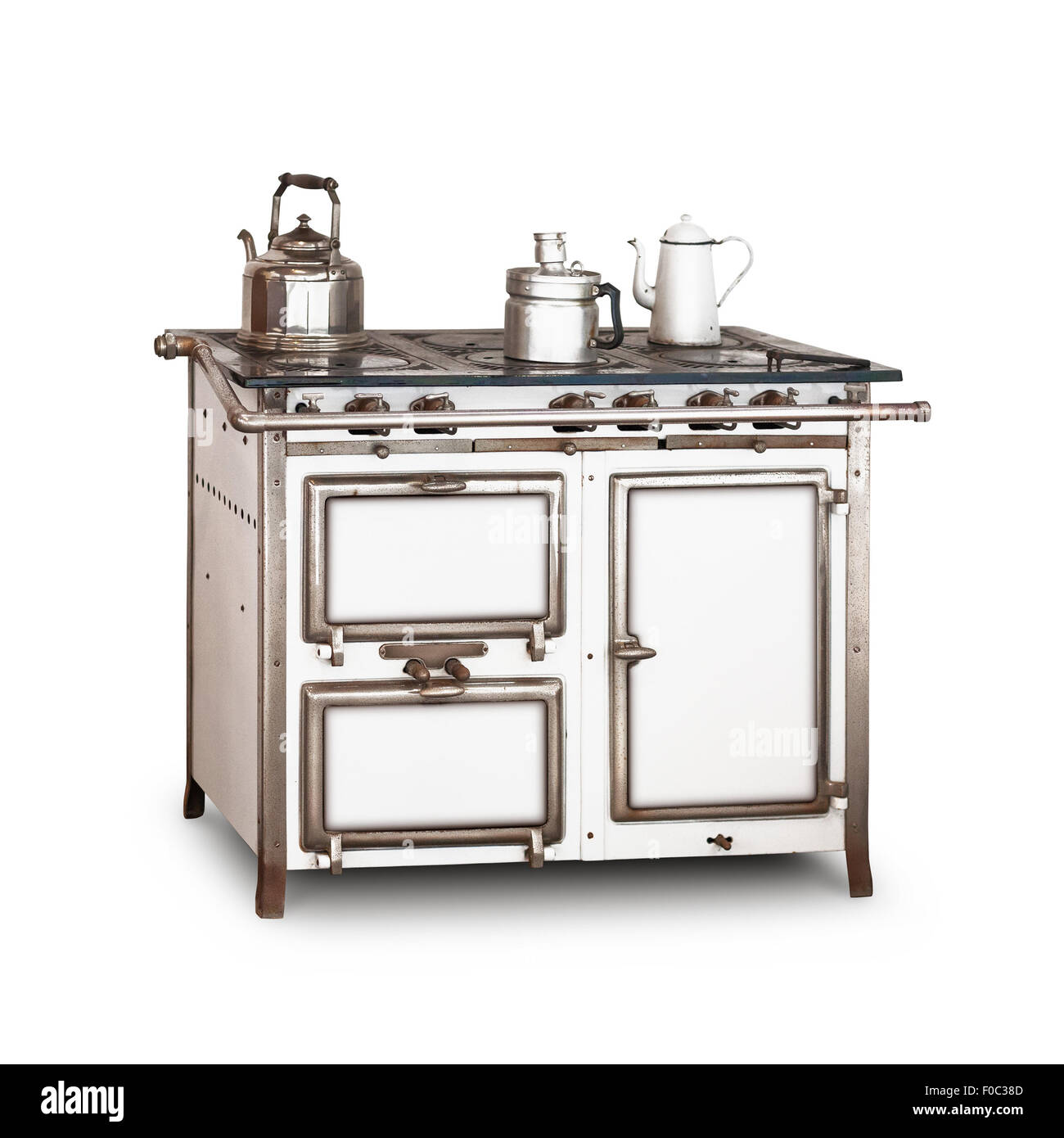Old gas stove with pot and kettle isolated on white background. Vintage kitchen. Single object with clipping path - Stock Image