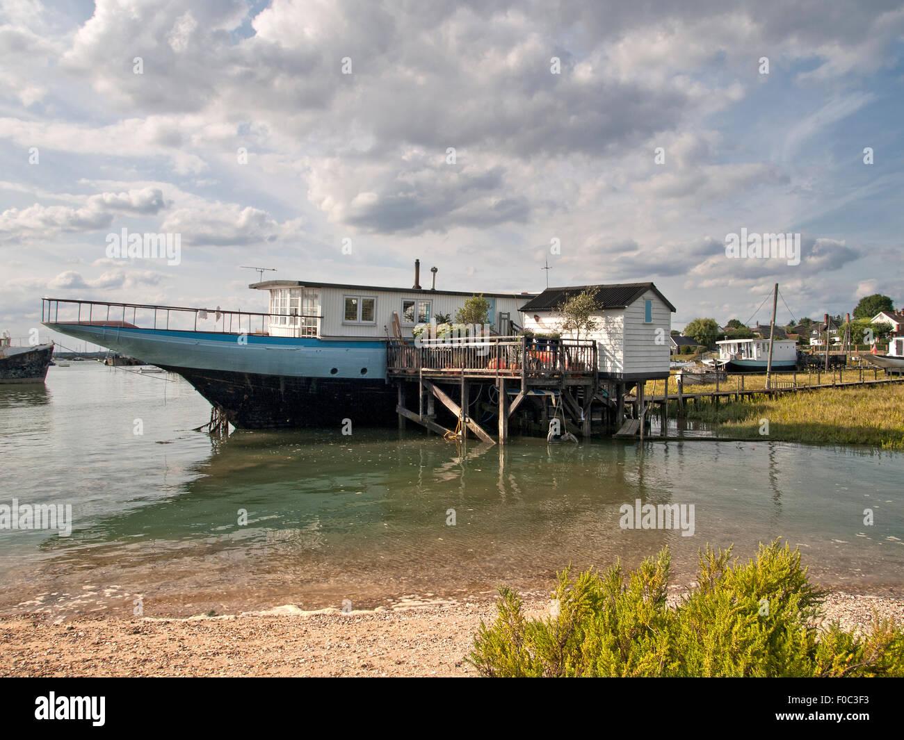 Houseboats on shoreline at West Mersea. Mersea Island. Essex. England. UK. - Stock Image