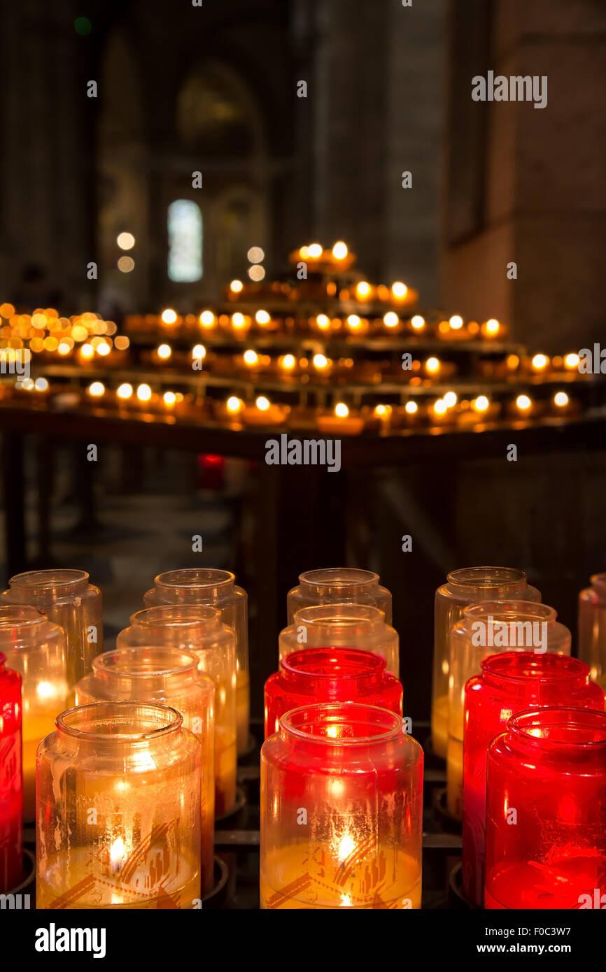 candles burning inside Basilica of the Sacred Heart of Jesus, Paris, France - Stock Image