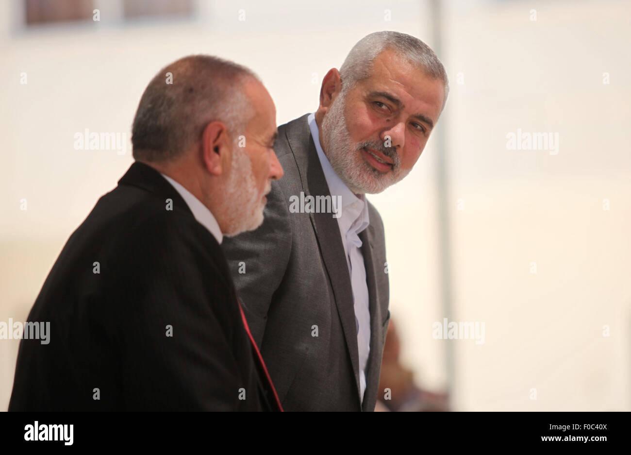 Gaza City, Gaza Strip, Palestinian Territory. 12th Aug, 2015. Senior Hamas leader Ismail Haniyeh, attends a protest - Stock Image