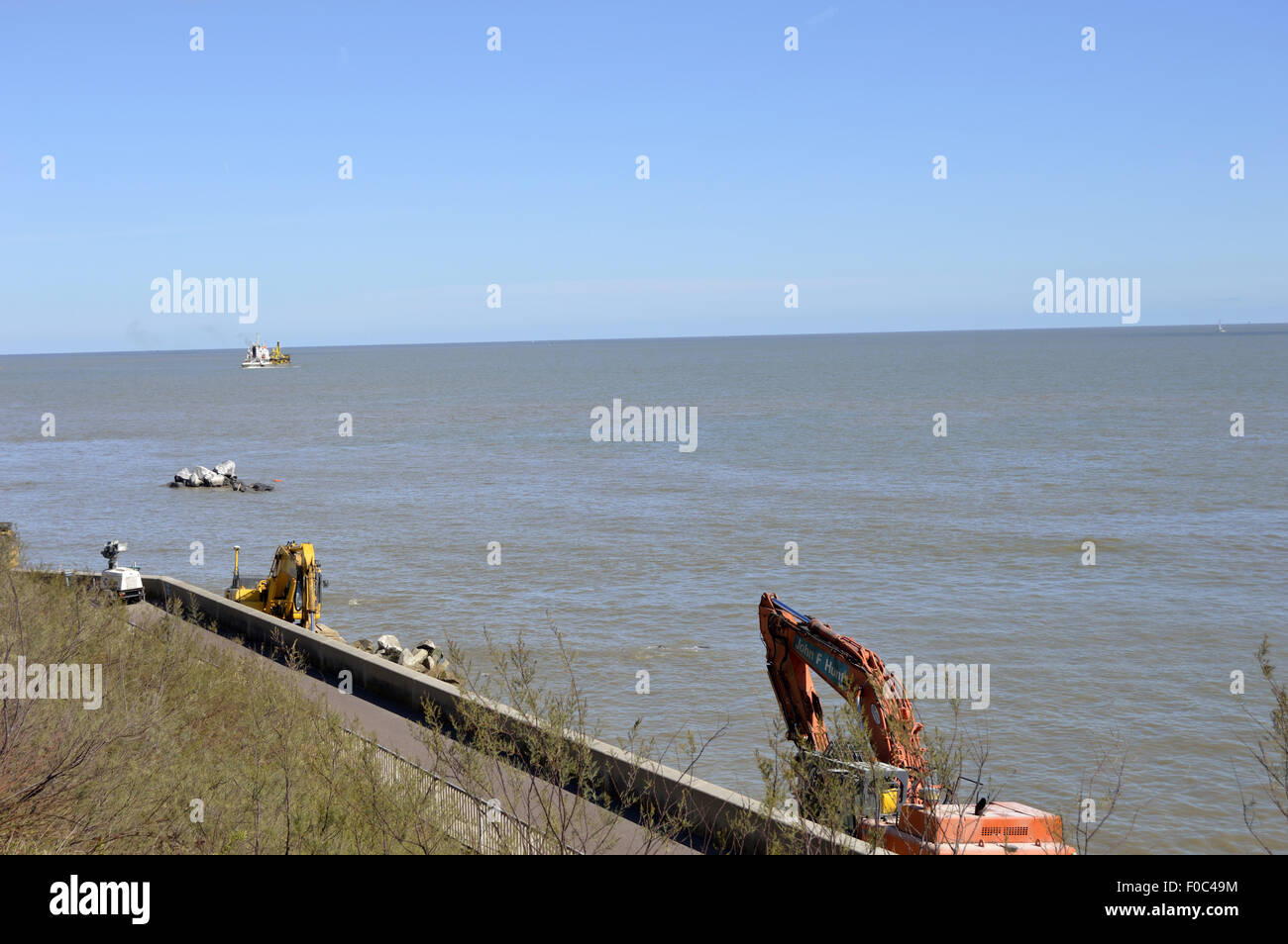 work being carried out on the new sea defences for the Clacton sea defences, to protect against erosion. - Stock Image