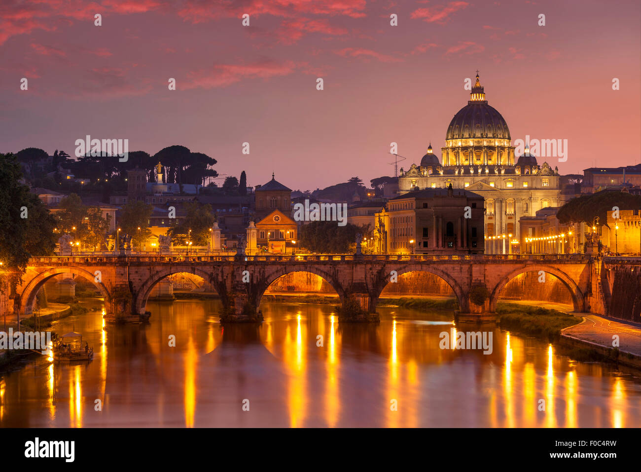 Sunset at Pont St Angelo and St Peters Basilica Vatican city Rome Lazio Italy EU Europe - Stock Image