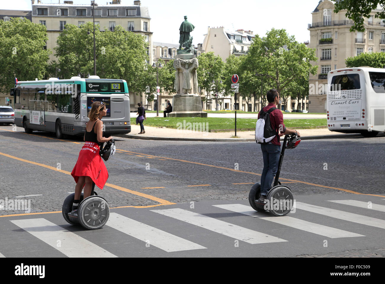 Segway crosswalk two people on segways crossing a road in Paris France - Stock Image