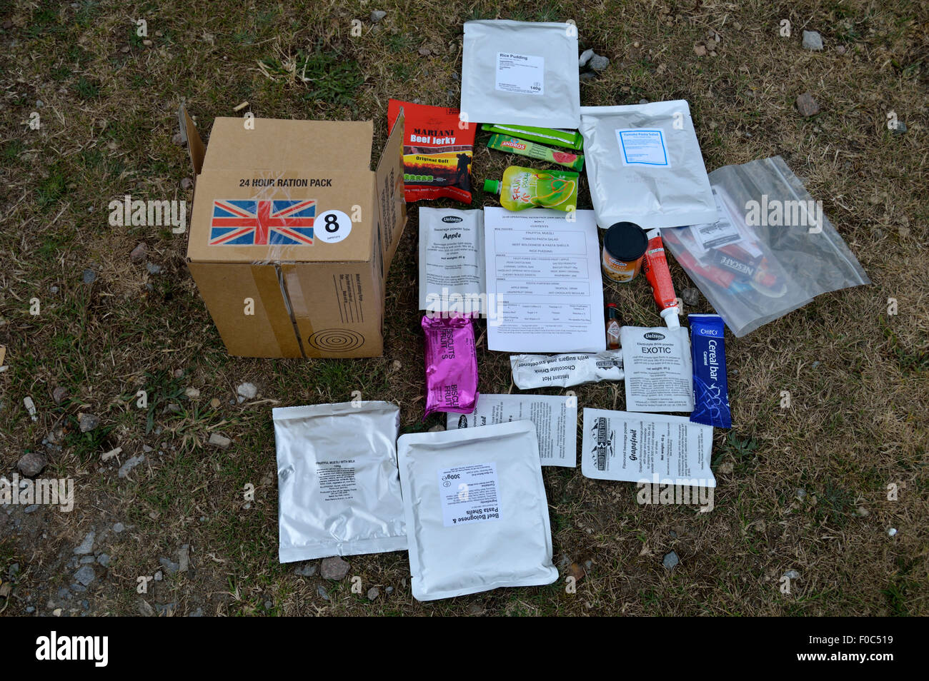 24 Hour ration pack contents with union Jack flag showing use of british army. - Stock Image