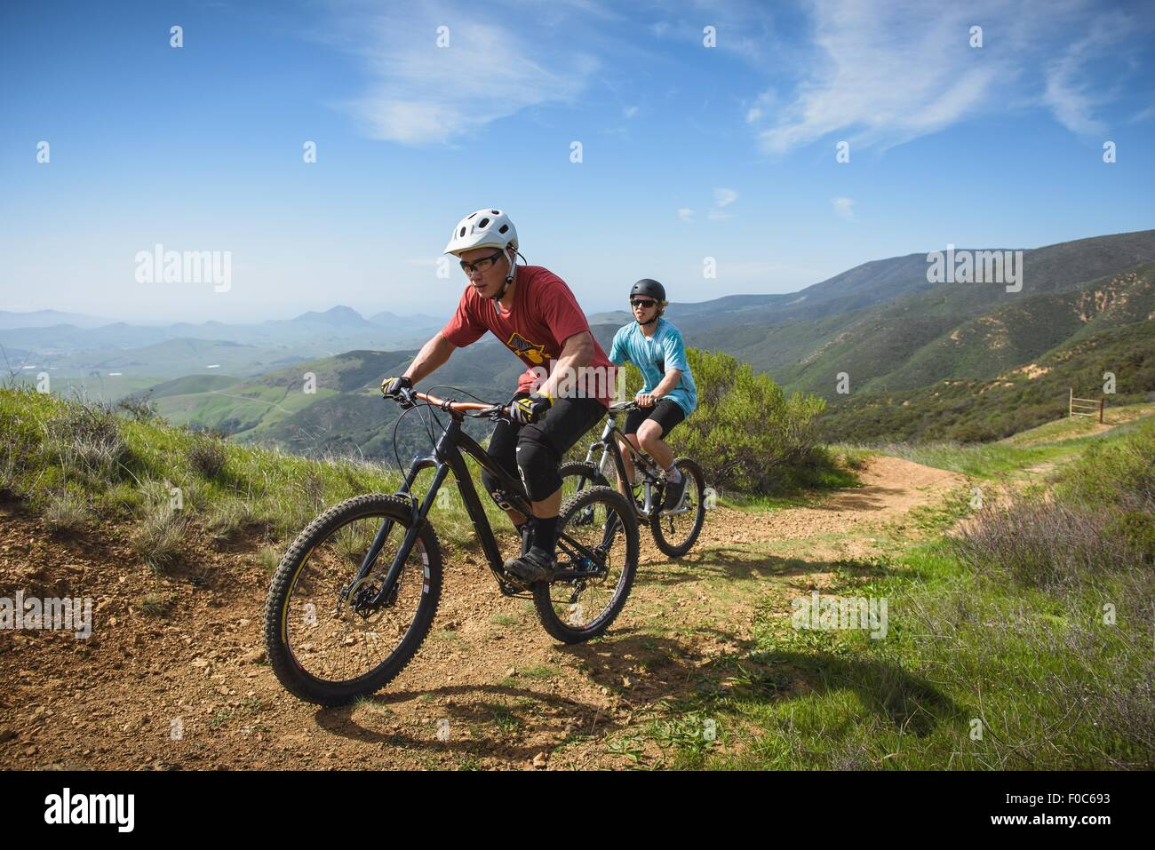 Cyclists mountain biking, San Luis Obispo, California, United States of America - Stock Image