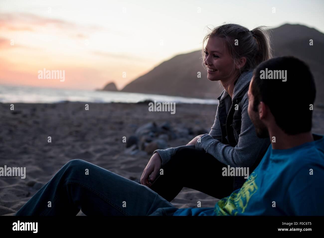 Couple on beach, Malibu, California, USA - Stock Image