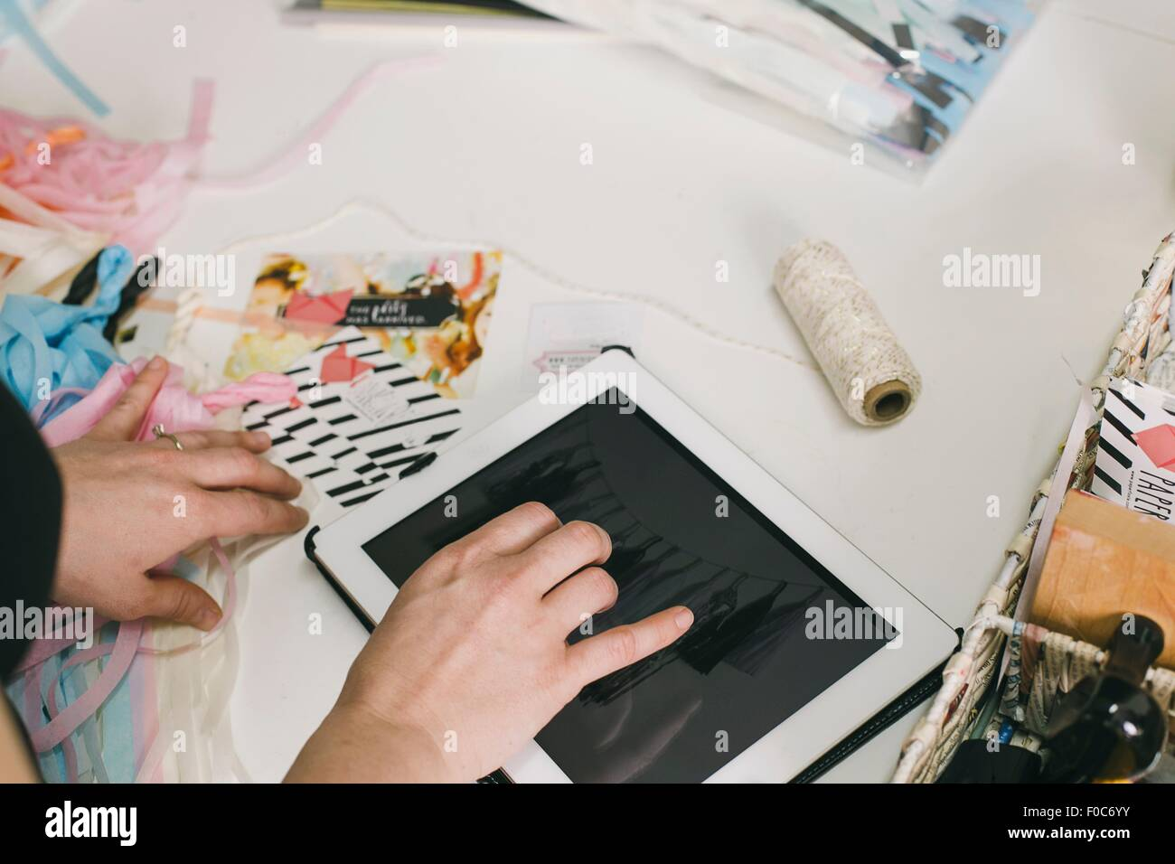 Close up female designers hands using digital tablet in design studio Stock Photo