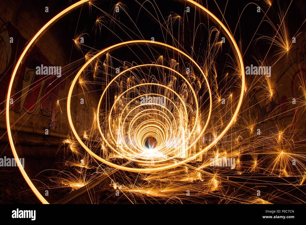 Train tunnel with light trails, low angle view - Stock Image