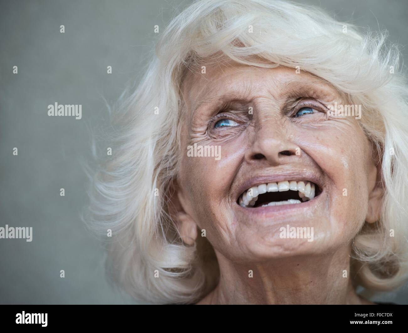 Portrait of senior adult woman, laughing - Stock Image