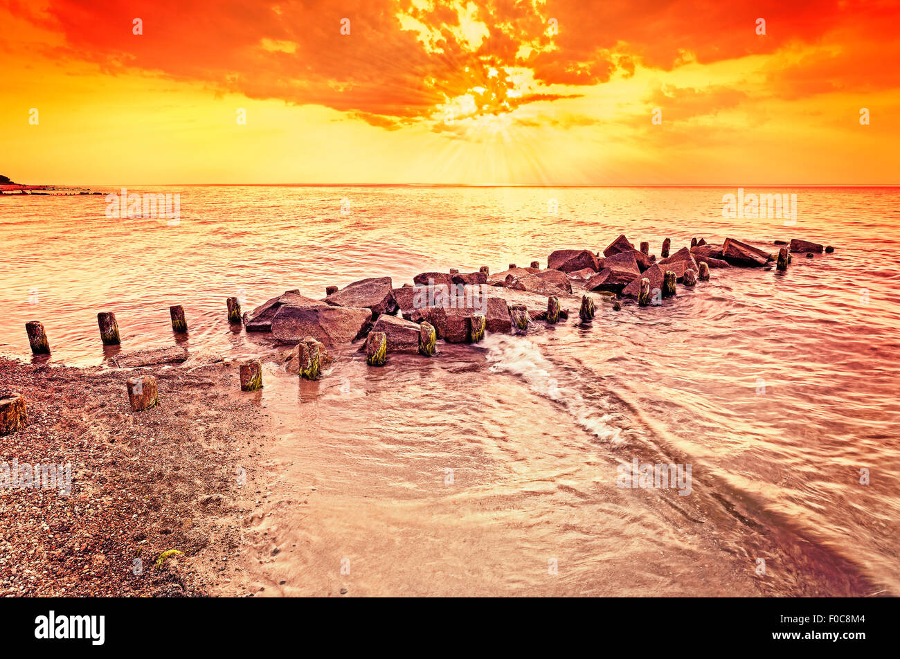 Beautiful amber sunset over beach, summer background. - Stock Image