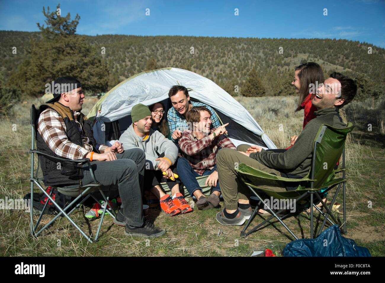 Group of friends at camp, Smith Rock State Park, Oregon - Stock Image