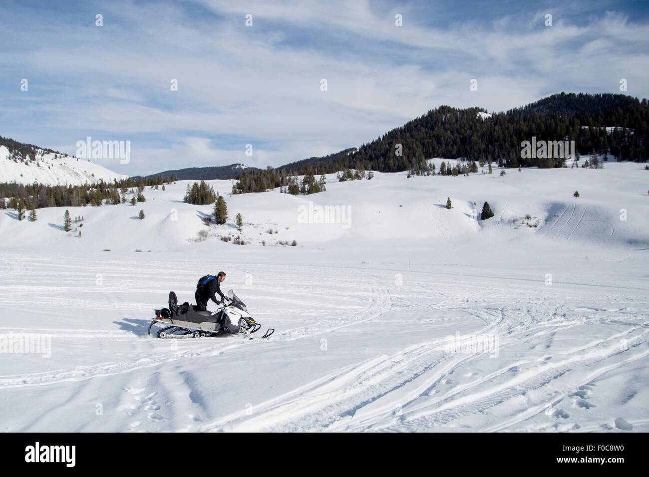 Man on snowmobile, Jackson Hole, Wyoming - Stock Image