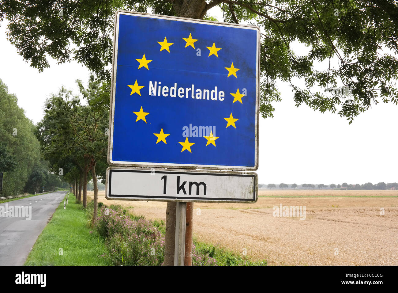 Draw near The Netherlands. Sign near the border of The Netherlands written in German. - Stock Image