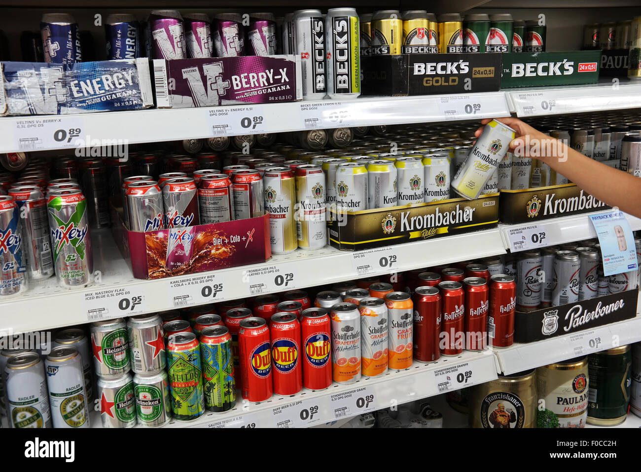 Aisle with a variety of Energy drinks and Radlers in metal cans in a Real Hypermarket. - Stock Image