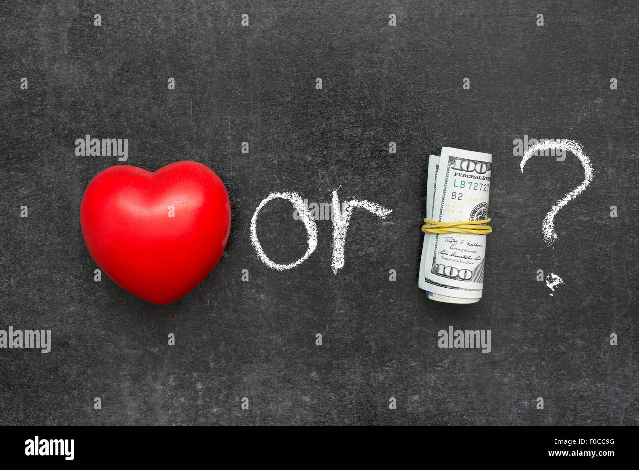 d1b9a682c7d9 love or money concept handwritten on blackboard with red heart symbol and  roll of US dollars