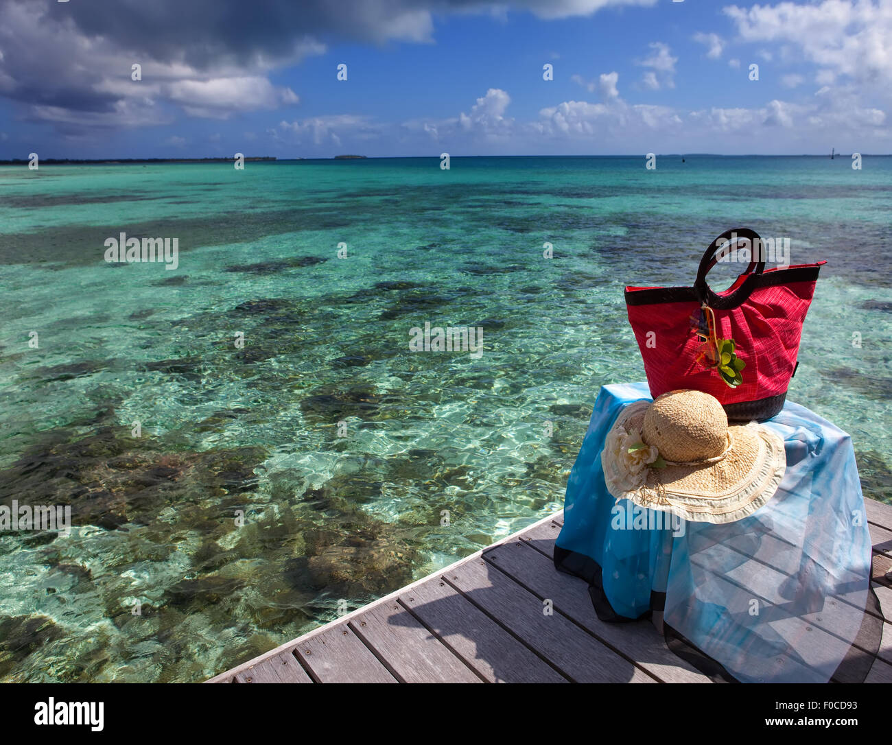 a60517c6af96 Red beach bag and and beach cape on sea background Stock Photo ...