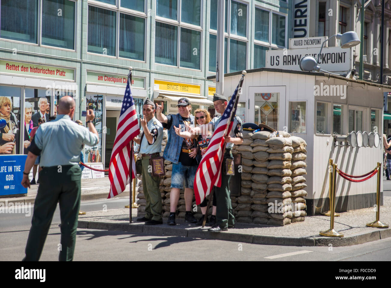 Tourists at Checkpoint Charlie, Berlin Stock Photo