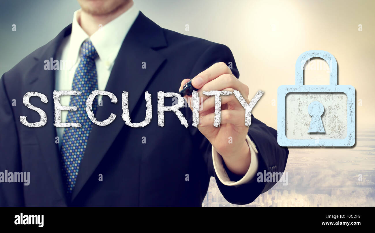 Businessman drawing security text and key lock concept - Stock Image