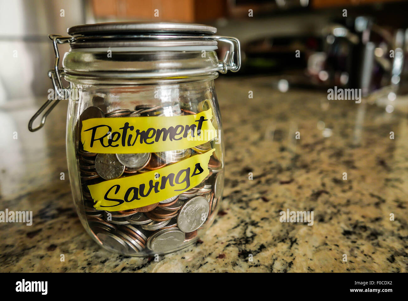 Retirement Savings Money Jar - Stock Image