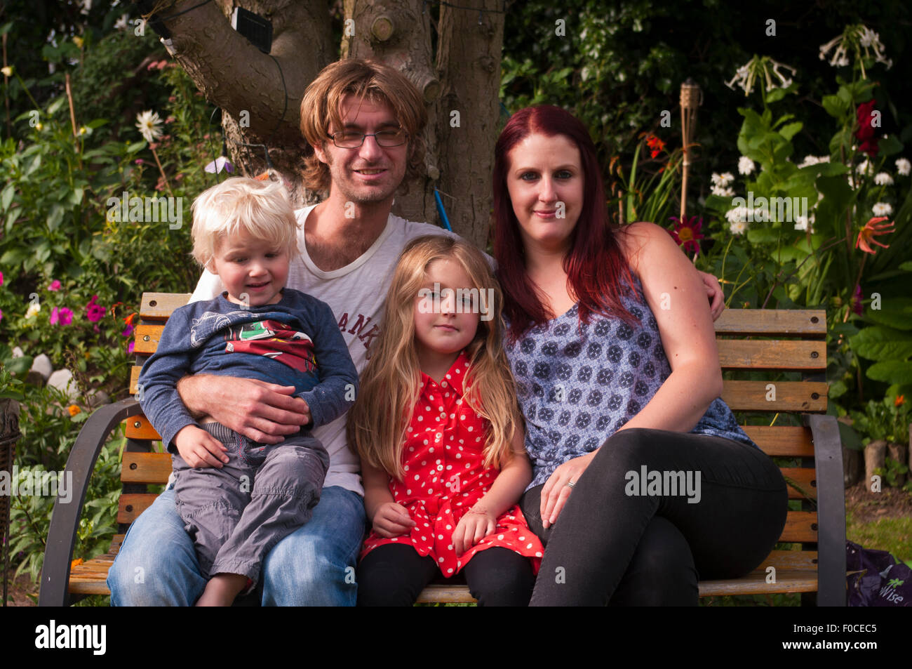 Family Portrait Of Mum Dad Son and Daughter - Stock Image