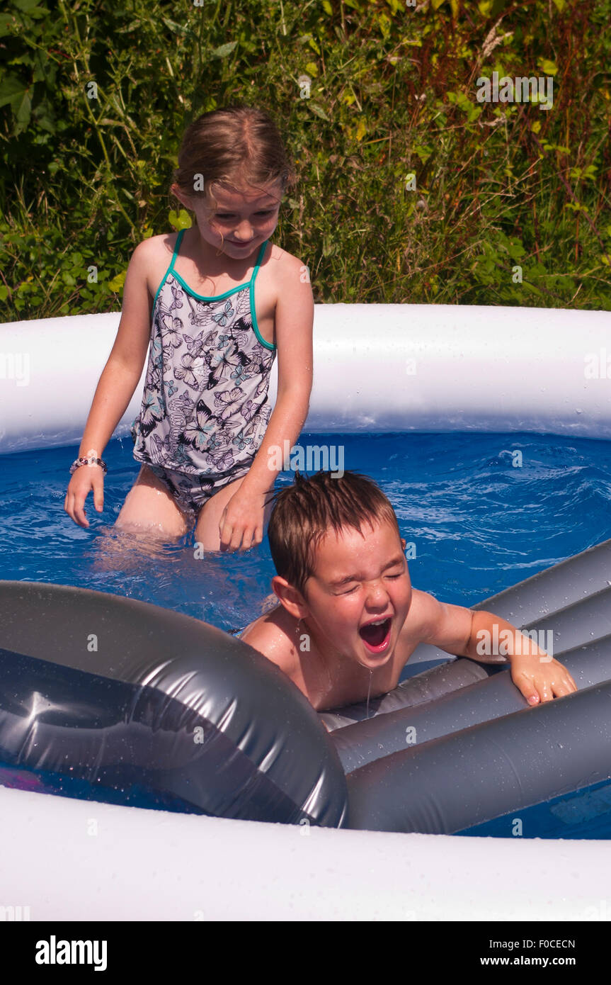 2 Children Cooling Off During Hot Summers Day Stock Photo