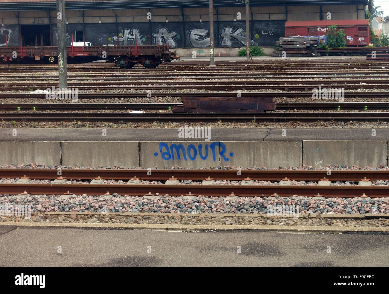 'Amour' ('love') graffito at French railway station, France - Stock Image