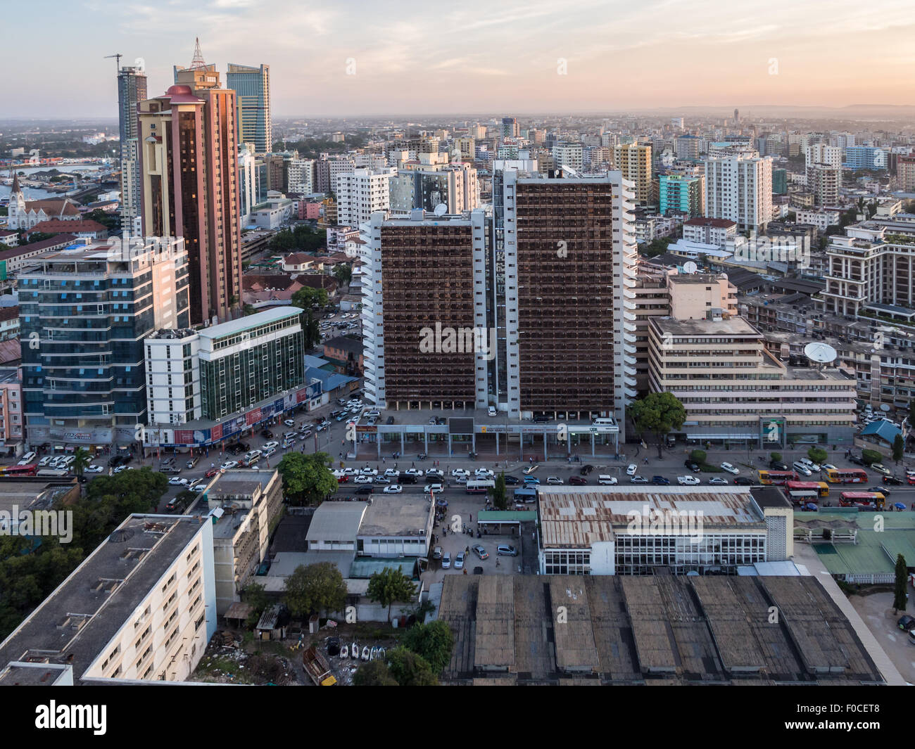 Modern skyscrappers in downtown of Dar es Salaam in Tanzania, East Africa, in the evening, at sunset. Horizontal - Stock Image