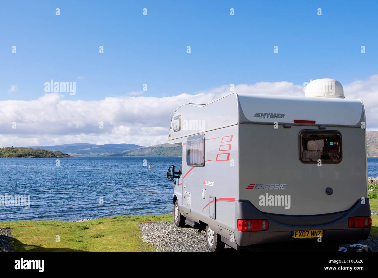 Hymer Motorhome in campsite overlooking bay and Sound of Mull. Craignure Isle of Mull Inner Hebrides Western Isles - Stock Image
