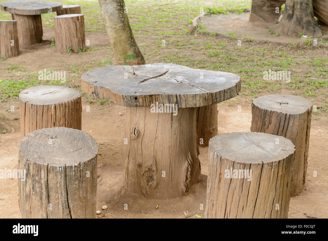 Exceptionnel Stump Chair And Wooden Table In The Garden   Stock Image