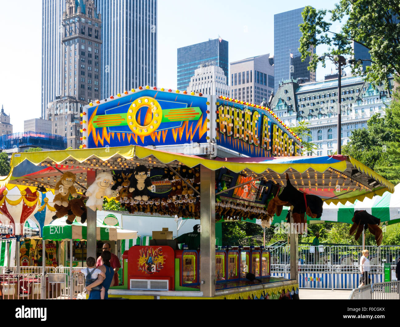 Victorian Gardens, Carnival Rides In Central Park With Midtown Manhattan  Skyline In Background, NYC