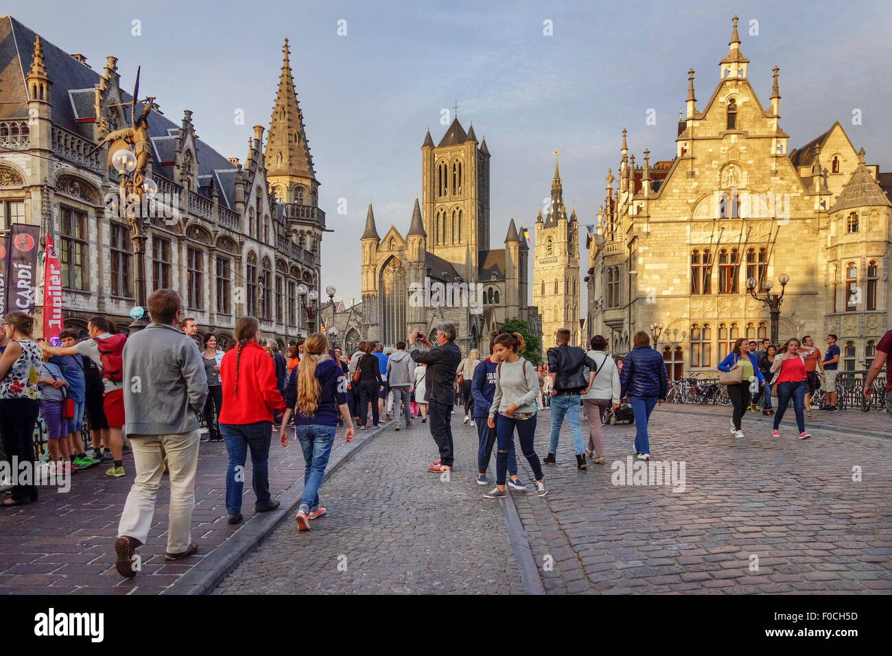 The Saint Nicholas' church / Sint-Niklaaskerk and the belfry in evening light at the city Ghent, Belgium - Stock Image