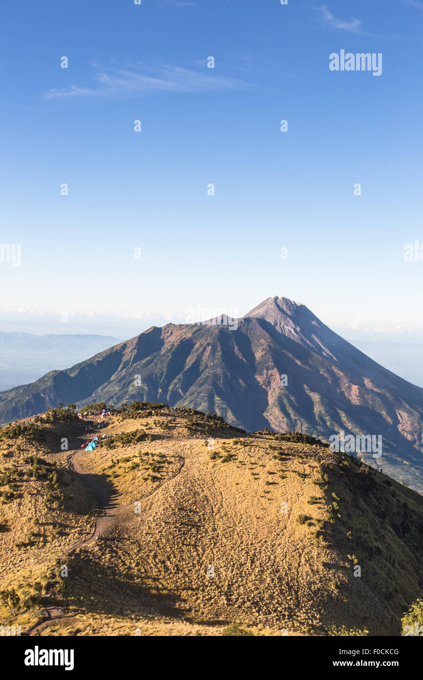 A view of Merapi volcano from the Merbabu volcano near the touristic city of Yogyakarta  in central  Java in Indonesia - Stock Image