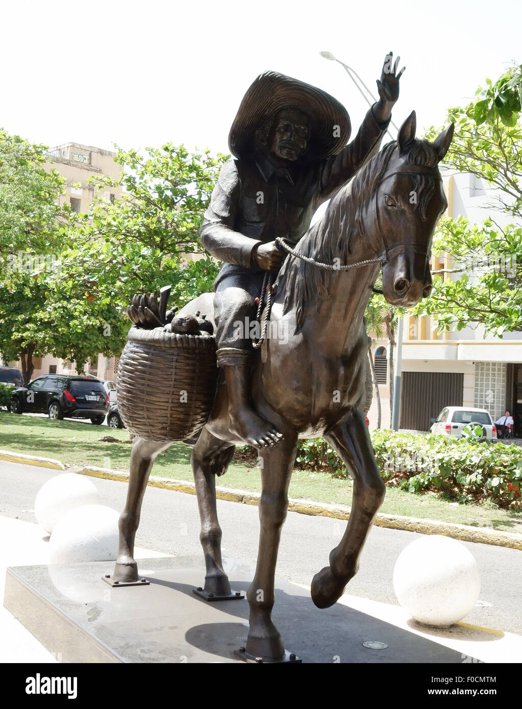 a bronze statue celebrating the rural Puerto Rican farmer of earlier times - Stock Image