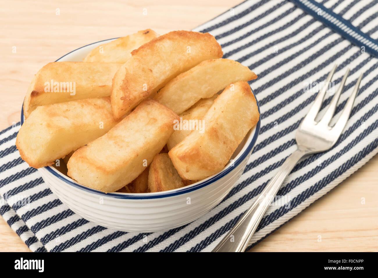 Bowl of French fries - studio shot - Stock Image