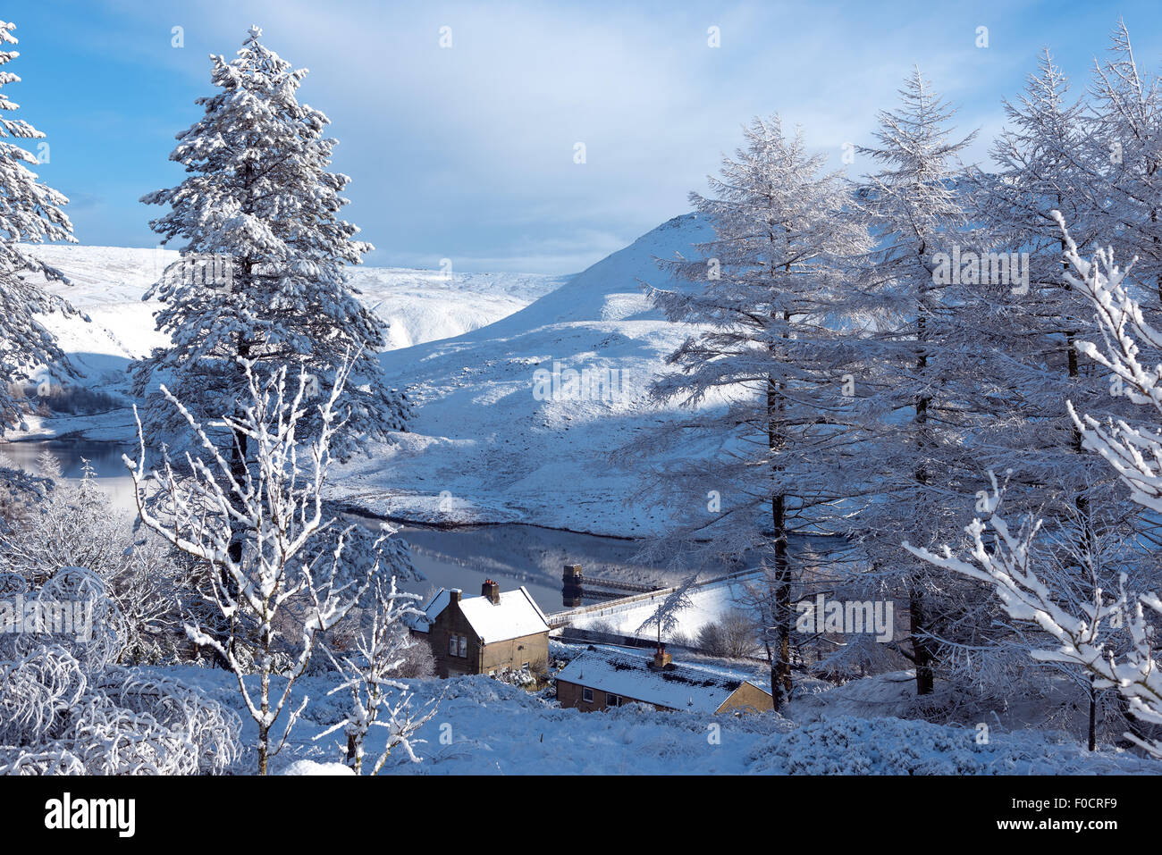 Fresh snow covering hills, trees and houses in the Peak district, North West England. - Stock Image