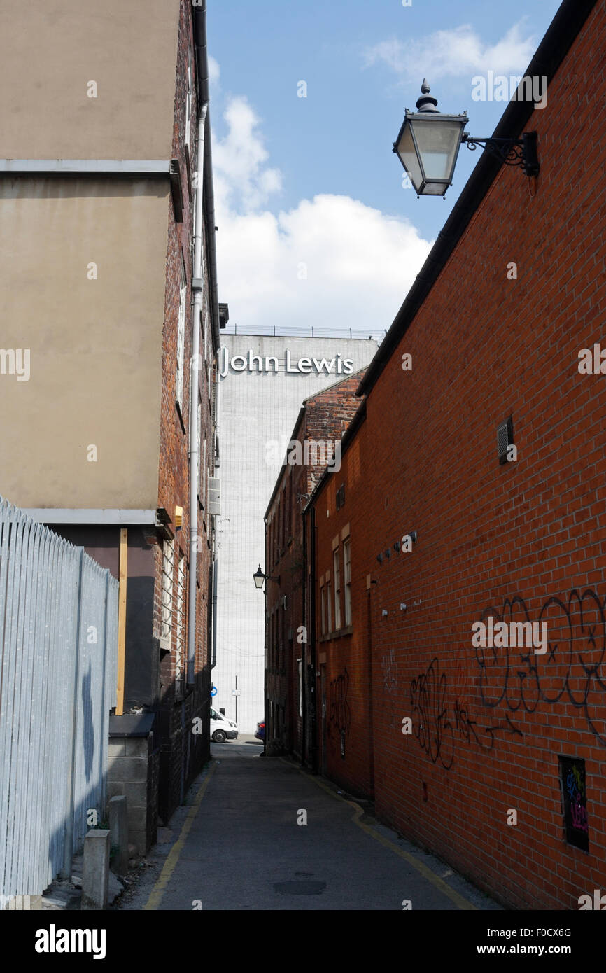 Alley way with old street lamp, John Lewis store in Background, Sheffield, Due for redevelopment - Stock Image