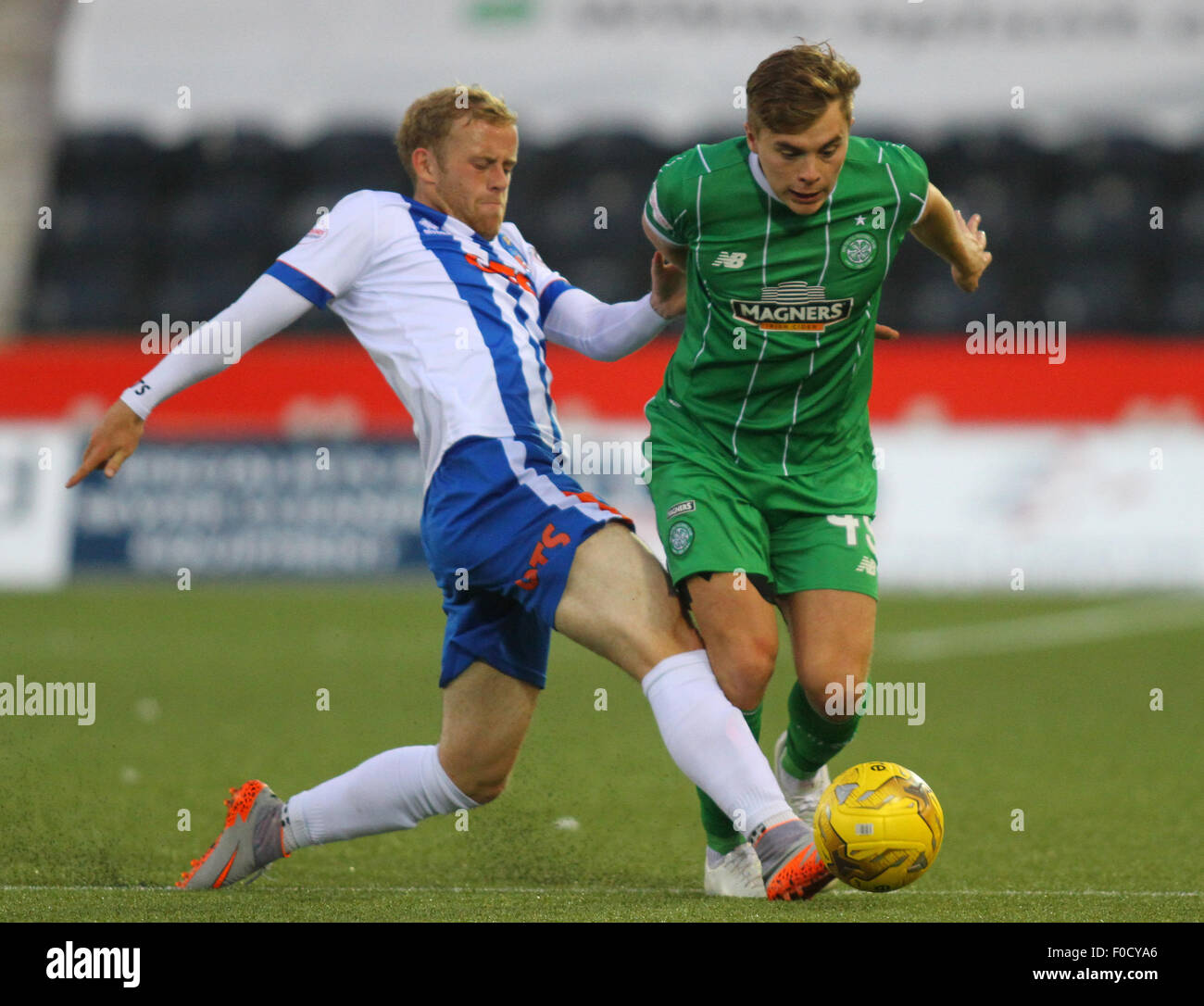 Kilmarnock, Scotland. 12th Aug, 2015. Scottish Premiership. Kilmarnock versus Celtic. James Forrest is tackled by - Stock Image