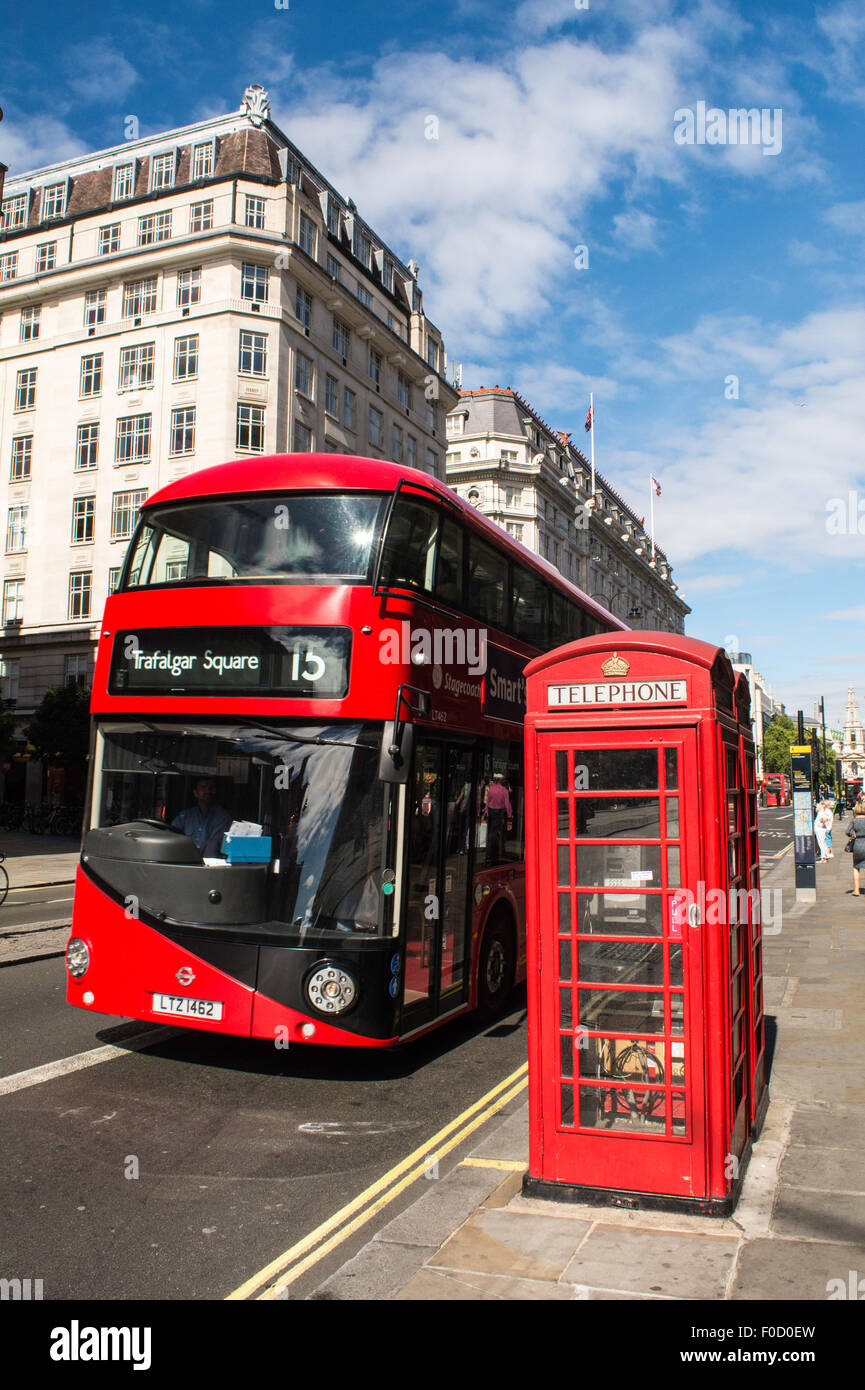 A new London Routemaster or 'Roastmaster' as it has become to be called passing a red telephone box on London's - Stock Image