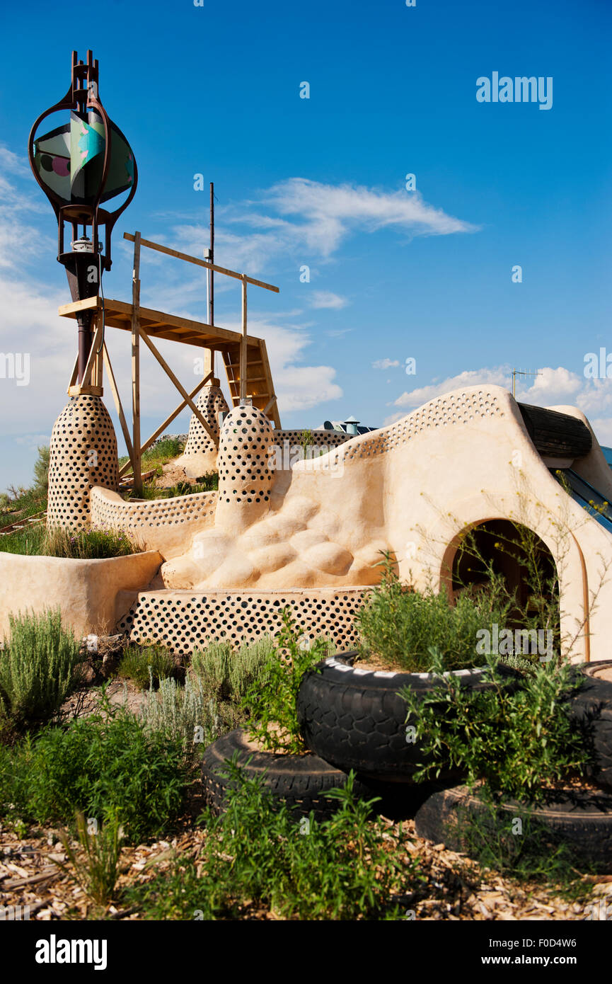 Earthship is a sustainable living complex made entirely of recyclable materials. It's just a short drive from - Stock Image