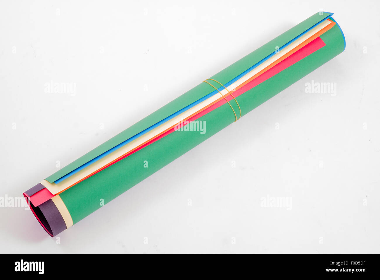 Roll of colored corrugated papers on white background Stock