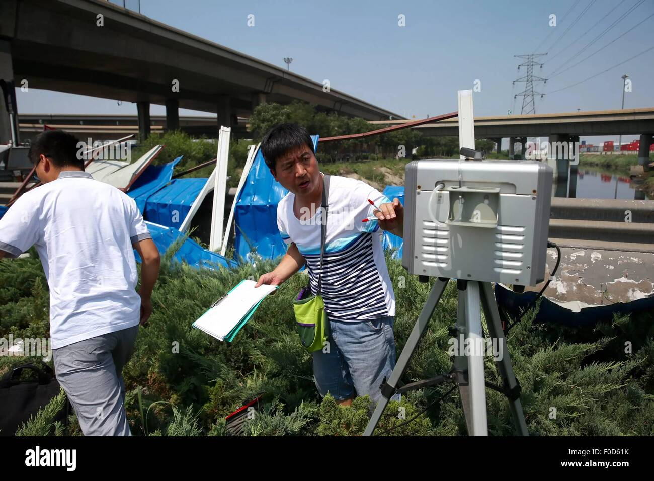 Tianjin, China. 13th Aug, 2015. Staff members of Tianjin Environment Monitoring Center monitors air quality near - Stock Image