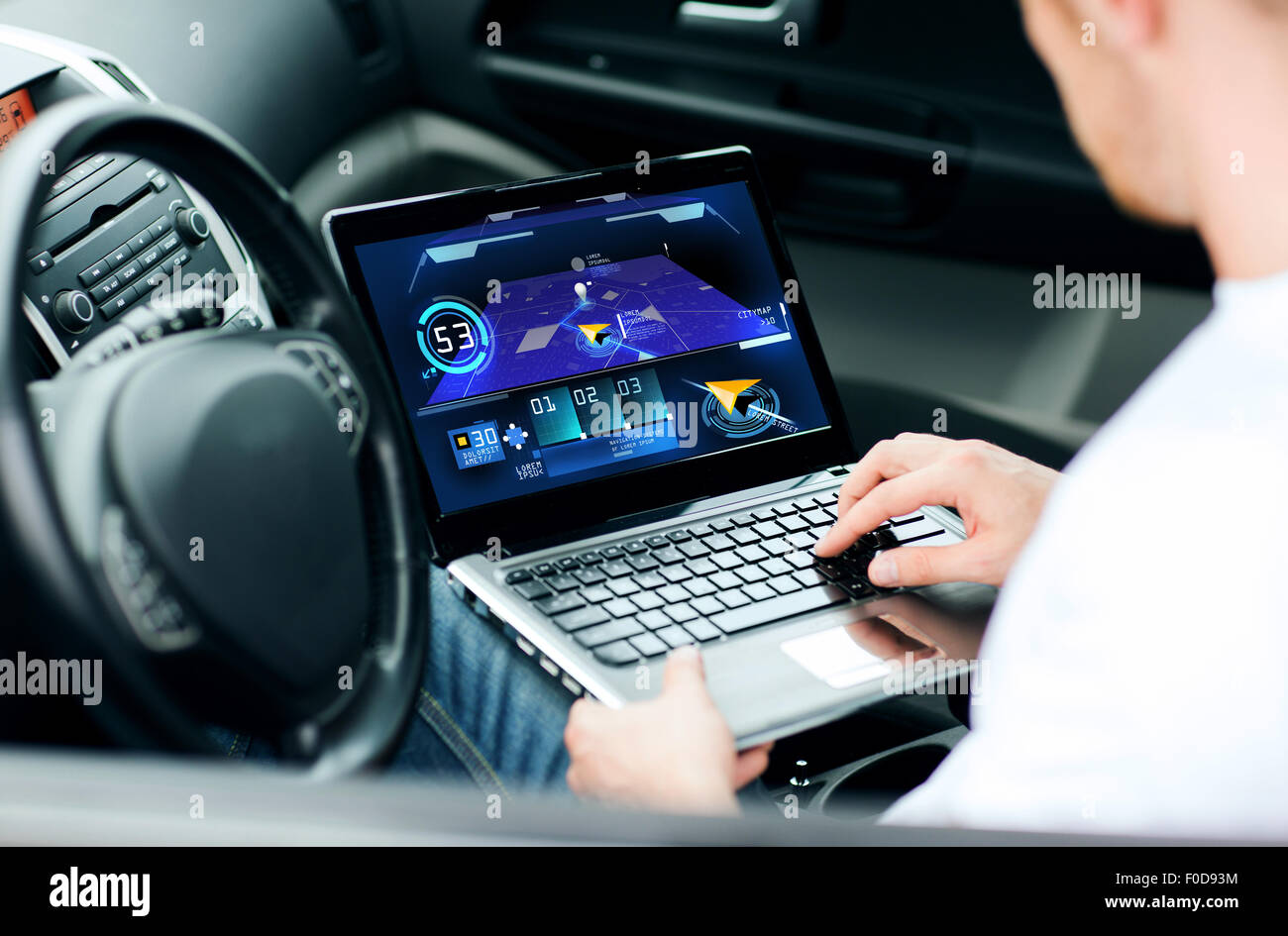 man using navigation on laptop computer in car - Stock Image