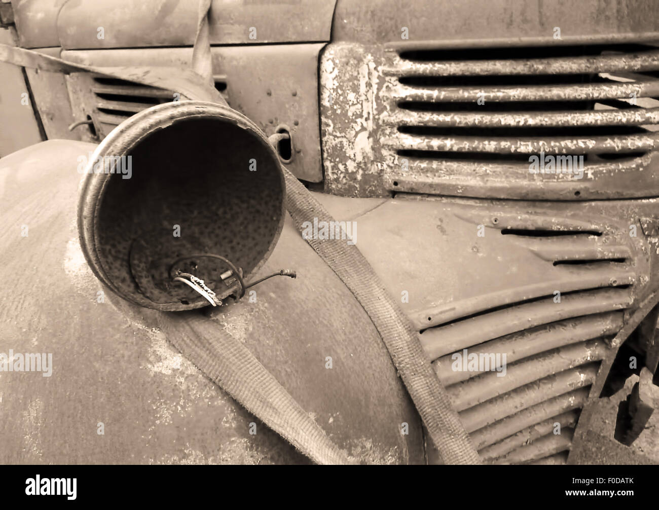 Closeup of rusty abandoned truck in sepia tones - Stock Image