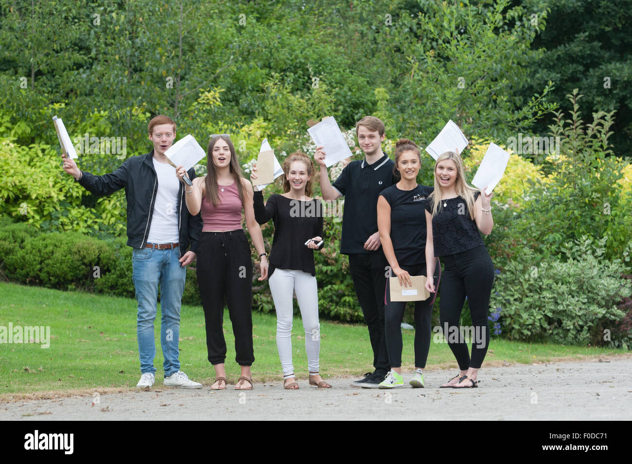 A Level results received by British school students - this group are from North Bromsgrove High School, Worcestershire - Stock Image