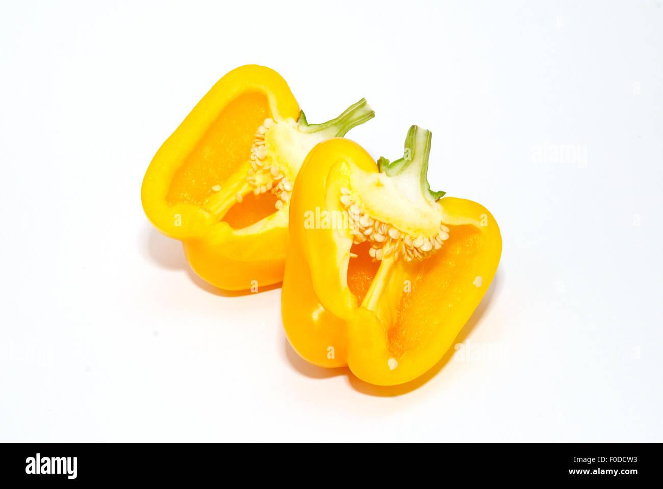 Two halves of slitting yellow paprika isolated on white. - Stock Image